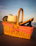 Picnic basket and hat Royalty Free Stock Images