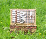 Picnic basket in meadow Royalty Free Stock Image