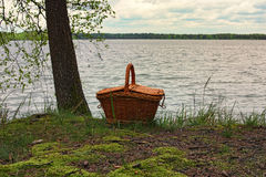 Picnic basket near the water. Amazing place for a picnic with view to the picturesque lake. Pisochne ozero. Volyn region. Ukraine Royalty Free Stock Photography