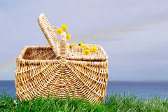 Picnic basket by ocean Stock Images