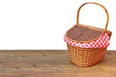 Picnic Basket On The Outdoor Wood Table Isolated Close-up. Picnic Wicker Basket Or Hamper On The Outdoor Wood Table Isolated On White Background Close-up Stock Photography