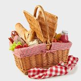 Picnic basket packed with a tasty summer lunch stock images