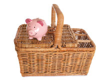 Picnic basket and piggybank Stock Photos