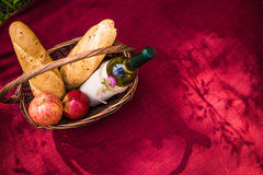 Picnic basket on the red blanket top view. Apples, white wine an Royalty Free Stock Image