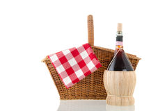 Picnic basket. With red checked napkin isolated over white background Stock Photos
