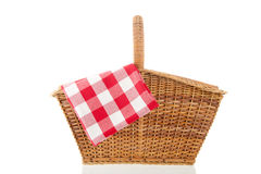 Picnic basket. With red checked napkin isolated over white background Royalty Free Stock Photo