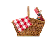 Picnic basket. With red checked napkin isolated over white background Stock Photo
