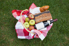 Picnic basket of red wine and bread Stock Photo