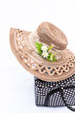 Picnic basket with straw hat. White background Stock Photos