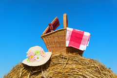 Picnic basket in summer. Picnic basket with wine and hat in summer time Royalty Free Stock Photo