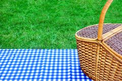Picnic Basket On The Table With Blue White Tablecloth Stock Photo