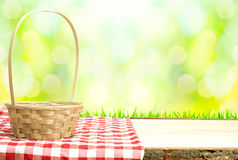 Picnic basket on table in nature Royalty Free Stock Photo
