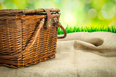Picnic basket  on the table with sack cloth Stock Photography