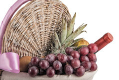 Picnic Basket with Tropical Fruits and Wine Stock Images