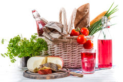 Picnic basket with vegetables and cheese Stock Photo