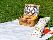 Picnic Basket On White Blanket With Pillows And Soap Bubbles. Picnic Basket Food On White Blanket With Pillows And Soap Bubbles Royalty Free Stock Image