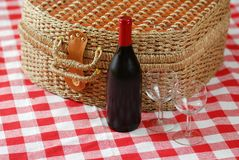 Picnic basket with wine. And glasses on classic cloth Royalty Free Stock Photos