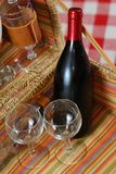 Picnic basket with wine. And glasses on classic cloth Royalty Free Stock Images