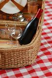 Picnic basket with wine. And glasses on classic cloth Stock Image