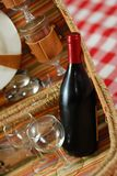 Picnic basket with wine. And glasses on classic cloth Stock Photography