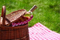 Picnic basket with wine bottle Royalty Free Stock Images