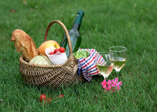 Picnic basket with wine, bread, vegetables. Picnic basket with white wine, bread, vegetables on grass stock image