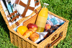 Picnic Basket With Fruits, Juice And Croissants Stock Photos