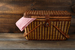 Picnic basket on wood Stock Image