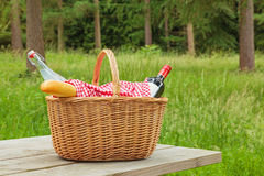 Picnic basket in a woodland setting Stock Photos