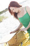 Picnic bastket time. A redhead at the beach, with a picnic basket Royalty Free Stock Images