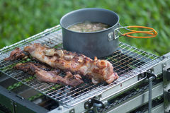 Picnic BBQ grills that have Boiler and soup on the stove on med Stock Photo