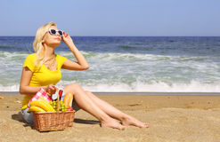 Picnic on the Beach. Blonde Young Woman Stock Photo