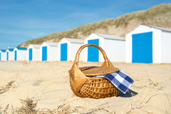 Picnic at beach with Blue huts Royalty Free Stock Image