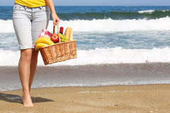 Picnic on the Beach. Female Legs and Basket Stock Images