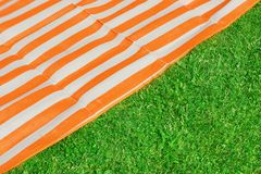 Picnic or Beach mat on the grass Royalty Free Stock Photography