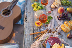 Picnic on the beach at sunset in boho style, food and drink conc. Picnic on the beach at sunset in the style of boho, food and drink conception stock photography