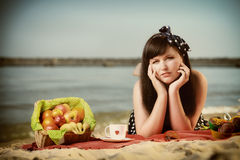 Picnic. Beautiful woman lying on the blanket Stock Images