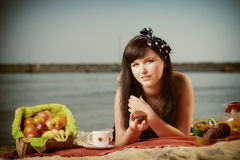Picnic. Beautiful woman lying on the blanket Stock Photo