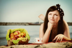 Picnic. Beautiful woman lying on the blanket Royalty Free Stock Photography
