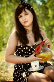 Picnic. Beautiful woman sitting on the blanket Royalty Free Stock Images