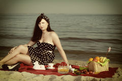 Picnic. Beautiful woman sitting on the blanket Stock Images