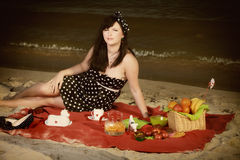 Picnic. Beautiful woman sitting on the blanket Royalty Free Stock Photo
