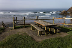 Picnic Bench at Beach. Picnic bench above Indian Beach at Ecola State Park in Oregon Royalty Free Stock Image
