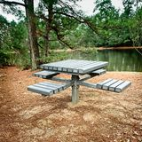Picnic Bench by a Lake. The Woodlands, TX USA - Feb 20, 2018 - Picnic Bench by a Lake stock photo