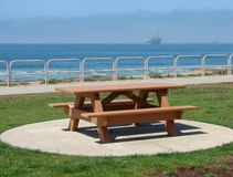 Picnic Bench Overlooking Ocean Stock Image
