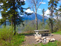 A picnic bench at a rest stop in the yukon territories Stock Photo