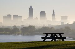 Picnic Bench Silohuette. Early morning silohuette of a picnic bench in Edgewater park just west of Cleveland with the skyline in background Royalty Free Stock Photos