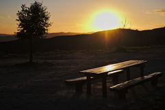 Picnic bench during sunset Royalty Free Stock Photo