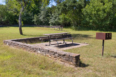 Picnic benches stone walls and a grill Royalty Free Stock Photo