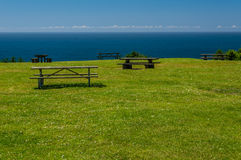 Picnic benches and tables at the ocean Royalty Free Stock Photo